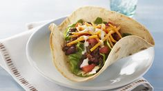 Taco Salad Made Over  This is so easy to make and the kids have fun putting the toppings on themselves. I just omit the chili powder in my recipe!