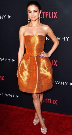 Selena Gomez in an orange strapless Oscar de la Renta dress