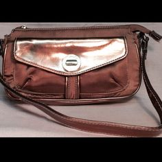Metallic gold Isaac Mazarhi small purse Limited edition, Isaac Mazhari gold mettalic satchel. Fun size bag to carry and such a great color. Great length shoulder strap, zip up pocket in the interior lining wall with signature patch that also doubles for a card holder, great outside pocket with engraved gold turn knob to open and shut. Also has a rear pocket with zipper. Handle edges have some wear, inside small markings however this purse is in great condition and sturdy, ready to be worn…