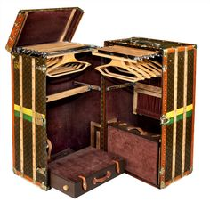 Louis Vuitton 'Malle Armoire' (wardrobe trunk).  France  Circa 1920's  A magnificent 'Malle Armoire' in L.V. 'Monogramme' canvas, the exterior with brass and leather trim, the exterior bearing 'A J DB Jr' monogram and yellow and green ID stripes.