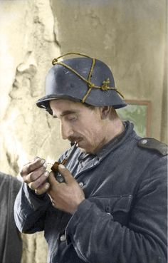 An older German soldier smoking a pipe in France (1944). (Colorized)