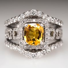 This striking yellow sapphire ring features three rings soldered together to make one sparkling wide band ring. The center ring is crafted of platinum and is centered with a carat natural yellow sapphire. The sapphire is surrounded by a halo. Diamond Earing, Halo Diamond, Sapphire Diamond, Yellow Sapphire Rings, Wide Band Rings, Gold Platinum, Mellow Yellow, Luxury Jewelry, Fine Jewelry