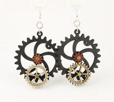 """Made in U.S.A Style # 5001B Size 1.65"""" x 1.5"""" Kinetic Gear Earring 5001B All Gears Move! Comes as shown - Black Satin/Natural Wood/Cherry Red Made from sustainably sourced materials Laser-cut wood Stained with water based dye Ear wires are silver-finished 3041 stainless steel with new electrophoretic-coating that resists tarnishing"""
