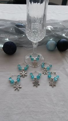 Pretty snowflake wine glass charms - make your Christmas dinner table more special.