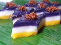 Sapin-sapin is a layered glutinous rice and coconut dessert in Philippine cuisine. It is made from rice flour, coconut milk, sugar, water, and coloring with coconut Brown Rice Cake Recipe, Sweet Rice Cake Recipe, Rice Cake Recipes, Rice Cakes, Dessert Recipes, Pinoy Dessert, Filipino Desserts, Filipino Dishes, Asian Desserts