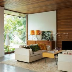 Comfortable retro living room with view of garden and shagpile rug