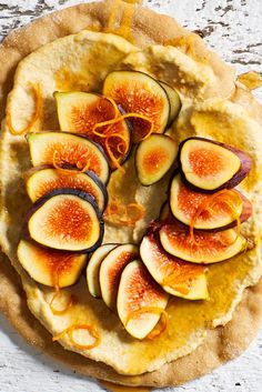 This simple flatbread showcases the natural sweetness of figs by pairing them with ribbons of floral orange zest and a creamy vanilla-infused spread. Perfect as a fruit-forward appetizer or light dessert, you can even bake the flatbread base beforehand and have it ready for quick assembly. Fresh figs are luscious in this recipe, but you can always substitute dried figs if they are out of season or not quite at their peak. Dried Figs, Fresh Figs, Vegan Casserole, Loaded Baked Potatoes, Light Desserts, Orange Zest, Pot Pie, Vegan Baking, Enchiladas