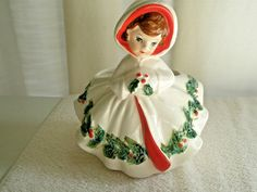 She has holly on the muff, and all around the skirt of the coat. Berries adorn the front and sides, and muff. She measures h. x 5 w. I found no cracks, chips or hairlines on this beauty! Elf On The Shelf, Vintage Christmas, Hoods, Berries, Disney Princess, Holiday Decor, Lady, Coat, Chips