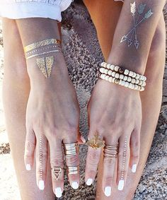 The Prettiest Commitment-Free Tattoos Ever Metallic temporary tattoos are the latest trend to try