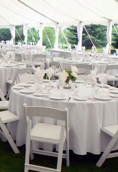 Tent @ Knollwood. The more I look at this, the more I realize the centerpieces can be really simple. I'd just like them to add a splash of color.