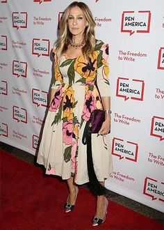 Sarah Jessica Parker wearing a The Row Satin Tassel Detail Grape Wristlet Bag https://api.shopstyle.com/action/apiVisitRetailer?id=511547144&pid=uid7729-3100527-84. #style #celebstyle