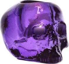 Purple glass skull votive holder.