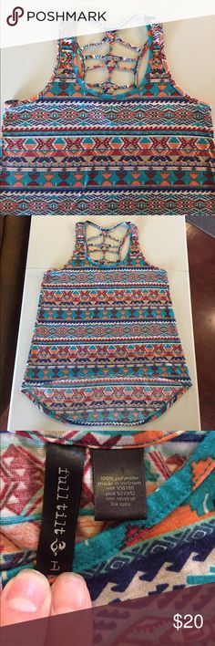"""Full Tilt Aztec Print Strappy Tank Top Large Full Tilt Aztec Print Strappy Hi/Low Tank Top. Tank is 28"""" from shoulder to hem in back and 22"""" long in front. Bust measures 18"""" laying flat. Tank is in excellent condition. The only sign of wear is the fading laundry tag. Comes from a Smoke Free/Pet Friendly home. Offers always welcome. Full Tilt Tops Tank Tops"""