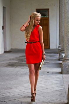 Classic silhouette in a vibrant red. Love the skinny belt & funky heels. Great look.