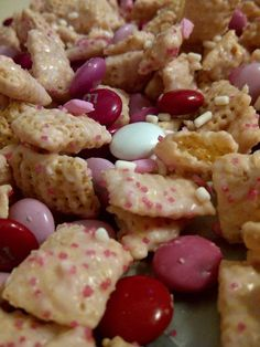 6 cups Rice Chex cereal 1 bag of white chocolate baking chips (12 oz) 4 T powder pudding mix from a box of Strawberry Creme Jell-O Pudding** (make sure you use pudding) 1 T Shortening Valentine M 's, sprinkles, food coloring