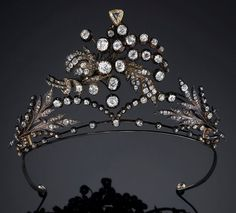 A floral belle epoque tiara, circa 1880, from an important private collection in Hanover. Designed as an open work foliate series of sprays and flower heads. Sold by Sotheby's Amsterdam on 27th March 2007, fetching 42,00 euros