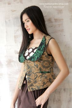batik amarillis's crescent vest. Refined tailoring and a half-moon shaped collar define this sophisticated, graphic statement piece, wear it alone or layer it over T-shirts, shirts or any kind of inners, this will keep you chic all day long! made of tenun batik gedog lawasan Tuban-Indonesia