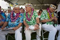 Pearl Harbor survivors Michael Ganitch, far left, of California and Robert McCoy, center, of Hawaii talk during the 71st Annual Memorial Ceremony commemorating the attacks on Pearl Harbor at the Pacific National Monument in Pearl Harbor, Hawaii, Dec. 7.