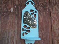 Shabby chic mirror Turquoise aqua Mirror wall shelf. Aqua shabby chic mirror and shelf. This is an up cycled OOAK piece! Hand carved solid wood from the 1970s. Painted with aqua chalk paint and hand distressed.