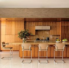 a mid-century modern style kitchen with wood and terrazzo   via coco kelley