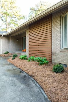 After photo showing stained outdoor modern wood slat accent wall on brick Ranch home. Ranch Exterior, Wall Exterior, House Paint Exterior, Exterior Remodel, Modern Exterior, Exterior Design, Exterior Homes, Stained Brick Exterior, Wood Slat Wall