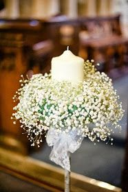White candle surrounded by mounds of baby breath! Beautiful.