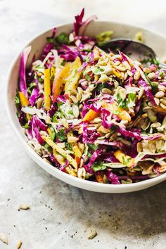 A detox summer slaw that combines the cleansing properties of apple cider vinegar and parsley and infused with healthy fats and stone fruit. It's easy to throw together and can be made ahead of time.