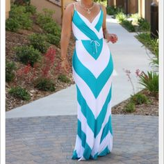"""Bebe Chevron Teal/White Maxi Dress Hello, weekend must-have! With a luxe wrapped neckline, drawstring waistband and bold stripes, this bebe dress is a resort-chic must have. Made from ultra soft fabric with high elasticity. Comes with full interior lining and adjustable straps. Try it with a white or gold sandal for a glam update. 100% viscose. Center back to hem: 53"""". (Maxi color is Teal) bebe Dresses Maxi"""