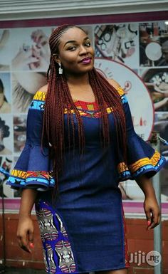 Next Previous A beautifully finished Embellished Denim dress with Ankara detailing. Suitable for office wear and outing. You'll sure look unique in this bespoke dress… call now to place an order. Short African Dresses, African Blouses, Latest African Fashion Dresses, African Print Dresses, African Print Fashion, African Prints, African Print Dress Designs, African Traditional Dresses, Trendy Ankara Styles