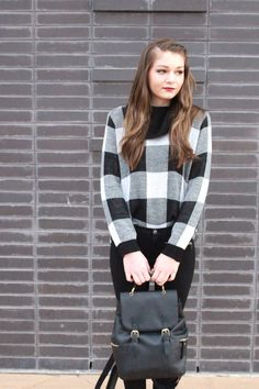 A cute leather backpack to match the large gingham print sweater, flattering black trousers, and black leather booties. Perfect autumn style