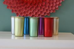 One of my best memories is drinking kool-Aid from these tumblers @ my Aunt Billies house in the summertime.  Set of Seven Vintage Aluminum Colored Tumblers or by JustZipity, $28.00