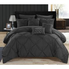 Enjoy a modern and sleek look with this black and white hotel collection bedding set that reverses into a large scale medallion two-toned pattern. Elegant details such as contrast red piping, decorati