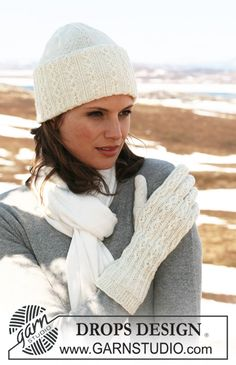 "DROPS 116-39 - DROPS hat and gloves in ""Fabel"" or Flora with cables."