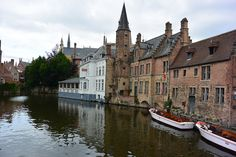 Riding in a riverboat down the canals in Bruges is a must do! The guide will regale you with tales of the buildings and town history. This is a cheap and great way to see the city. Bruges, Great Photos, Buildings, Mansions, History, House Styles, City, Shelf, Mansion Houses