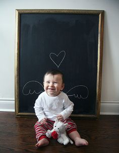 Framed Chalkboard...sooo many uses, like this baby photo background. #DIY