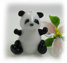 Lampwork Panda Bear and Flower done in boro glass...