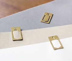 These rustic brass number clips are a surefire way to make organizing more stylish. They can also be used as bookmarks.