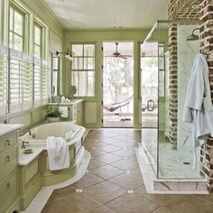 I love everything about this bathroom. Wall color, tile floor, and the single brick wall.
