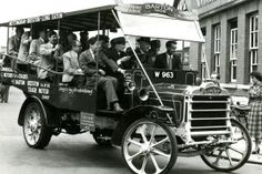 1953: Enthusiasts on board a replica of Barton's first charabanc which ran between Nottingham and Long Eaton