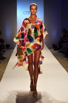 MIAMI, FL - JULY 21: A model walks the runway at the Caffe Swimwear show during Mercedes-Benz Fashion Week Swim 2014 at Oasis at the Raleigh on July 21, 2013 in Miami, Florida. (Photo by Frazer Harrison/Getty Images for Caffe Swimwear)