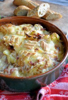 Tartiflette, a baked gratin of potatoes, onions (or shallots), lardons ...
