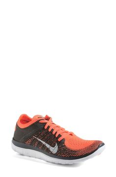Can't wait to sport these bright coral and grey Nike 'Free Flyknit 4.0' running shoes at the next marathon.