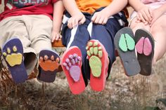 Transform flipflops into animal track shoes using a hot glue gun and sheets of coloured craft foam.
