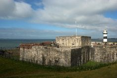 Photograph of Southsea Castle from outside, including the outer wall, keep and lighthouse  FREE