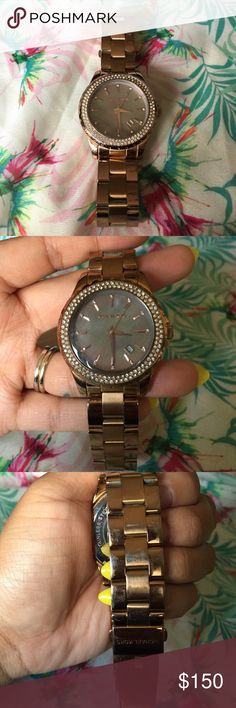 Michael Kors Runway Grey Mother of Pearl Rose Gold Michael Kors Rose Gold tone, Grey Mother of Pearl dial, Pave Crystal Bezel.. Just WOW! Stainless steel, battery working, box, manual, & links included. Minor use on bracelet (in pic) No scratches on the face, all crystals bright & intact! This watch is an eye catcher! Beautiful & Shiny! Model: MK5453 Orig. Price $225 Michael Kors Accessories Watches