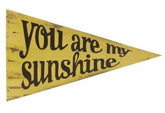 You Are My Sunshine, My Only Sunshine - a favorite song for many, this fun pennant made of fir wood and antiqued yellow finish, looks great in any room.