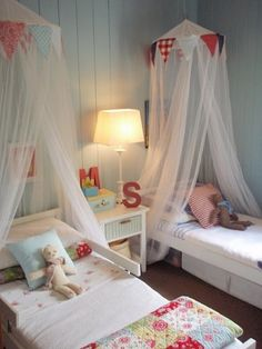Shared room.....love the canopy above the bed with homemade vintage fabric bunting!