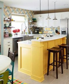 bold move with the island color and tile design