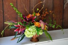Dahlias, lilies, roses, hydrangeas, orchids, vines, curly willow, fern, geranium