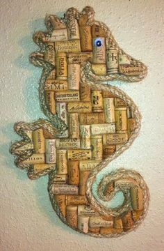 Unique seahorse wall art made with solid wood backing and real wine corks. Beautifully bordered with rope. This unique piece will be a great addition to your kitchen, bar, or man-cave. Great gift idea! Overall length is approx. 16 inches . As with all items, custom sizes accepted